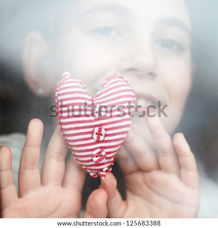little girl gives a heart
