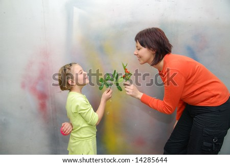 little girl giving gift to mother - stock photo