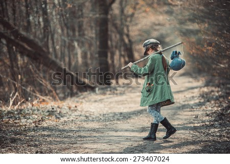 little girl goes through the woods with stuff, photo in vintage stylev - stock photo
