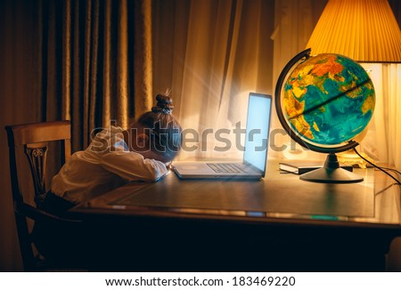 Little girl got asleep with laptop at night - stock photo