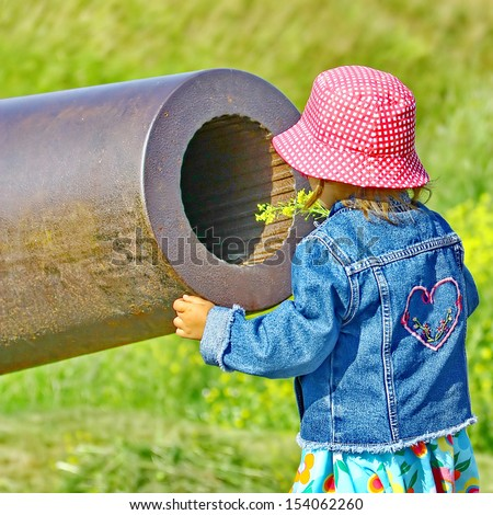 Little girl, gun and yellow flowers. Old Russian Cannon in Suomenlinna Sveaborg Helsinki Finland - stock photo