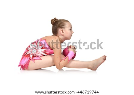 Little girl gymnast with pink ball
