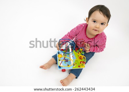 little girl happy with colorful wooden Toys isolated on white background - stock photo
