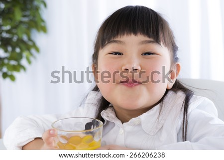 little girl have a drink of juice - stock photo