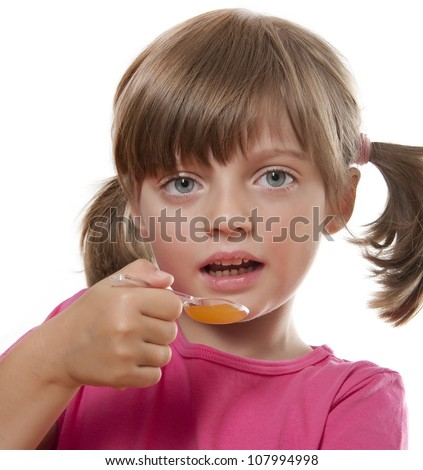 little girl have a spoon with syrup for cough