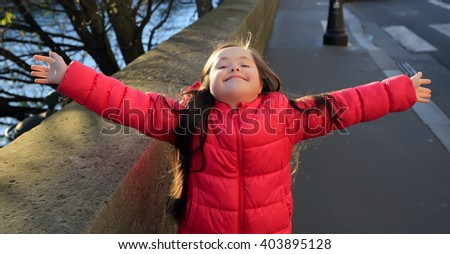 Little girl have fun on the street - stock photo