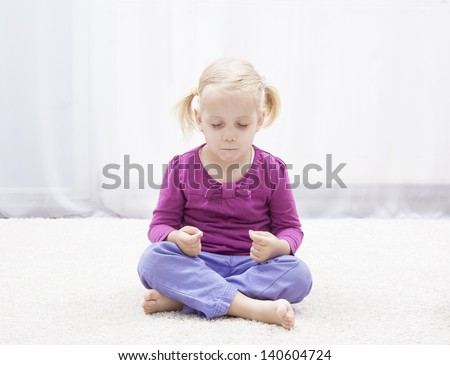 little girl have meditation in her room - stock photo
