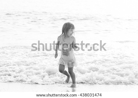 Little girl having fun on beach vacation. beautiful little girl on the ocean - stock photo