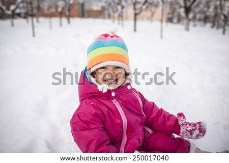 Little girl having fun on winter day - stock photo