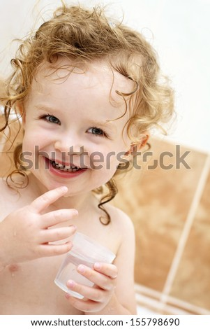 Little girl having fun while bathing - stock photo