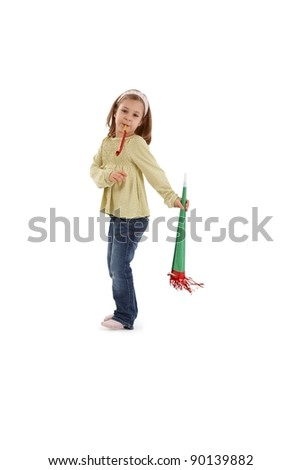 Little girl having fun with party accessories.? - stock photo