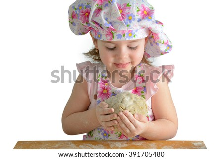 little girl holding a ball of dough on a white background - stock photo