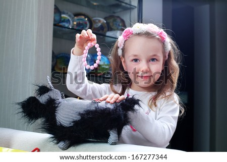 little girl holding a bracelet - stock photo