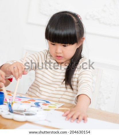 Little girl holding a brush, watercolor painting