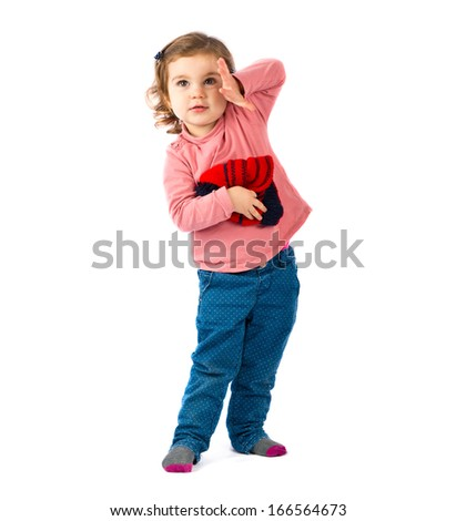 Little girl holding a Christmas hat over white background