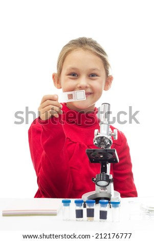 little girl holding a glass slide for the microscope