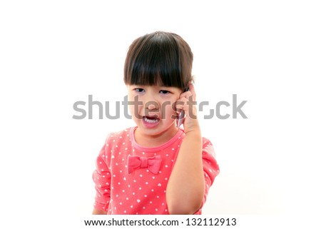 Little girl holding a mobile phone