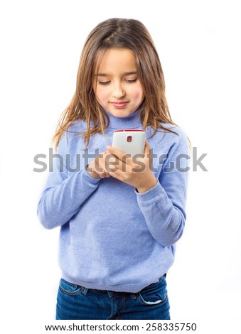 Little girl holding a smart phone against white background - stock photo