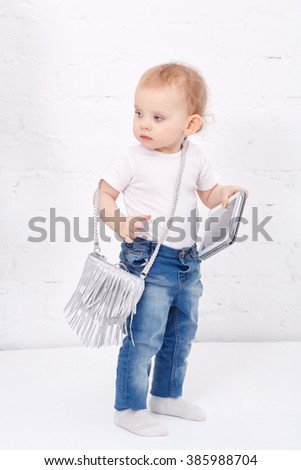 Little girl holding a tablet computer. Mobile technology. Happy childhood. Small business woman. - stock photo