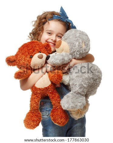 Little girl holding a teddy bear. Isolated on white background. - stock photo