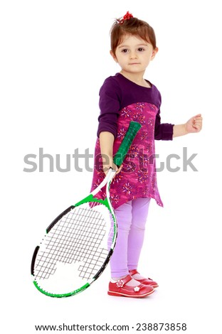 Little girl holding a tennis racket. Isolated on white background studio photo. - stock photo