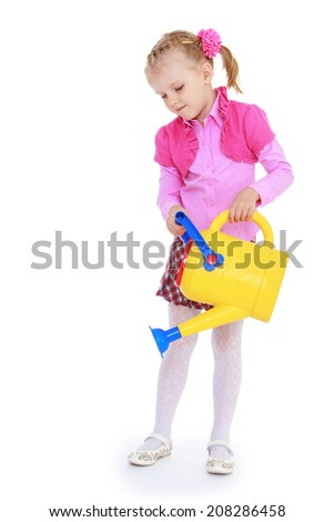 little girl holding a yellow watering can to water the plants.kindergarten, the concept of childhood and joy, teens - stock photo