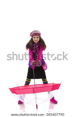 Little girl holding an umbrella - stock photo
