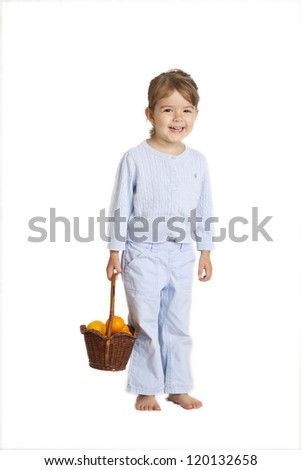little girl holding basket of oranges, clipping path included