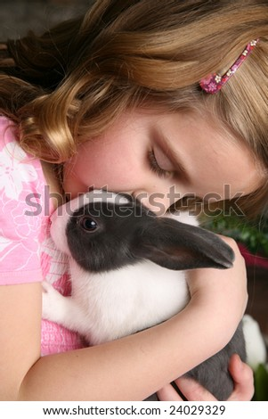 Little Girl Holding Bunny - stock photo