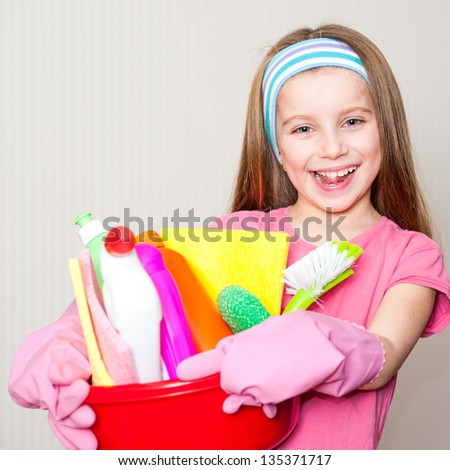 little girl holding colorful detergents