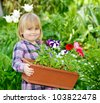 Little girl holding container with flowers - stock photo