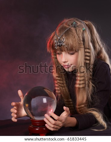 Little girl holding crystal ball.Series. - stock photo