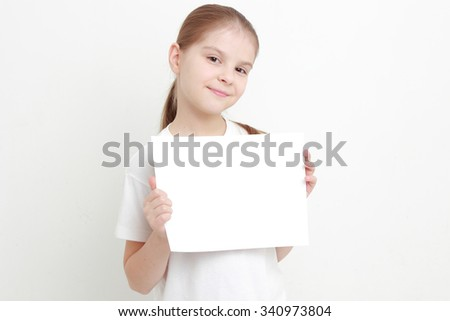 little girl holding empty white blank - stock photo