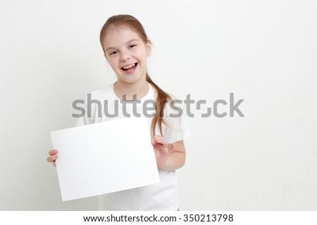 little girl holding empty white blank - stock photo