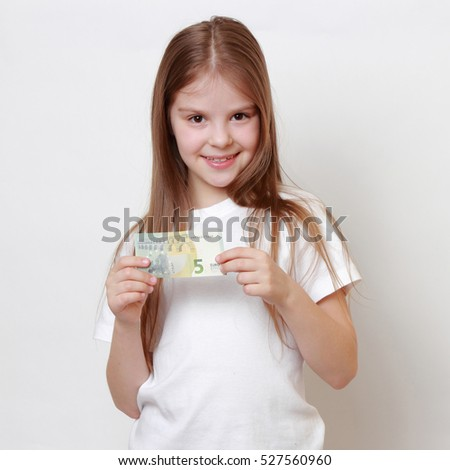 little girl holding euro