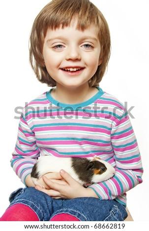 little girl holding guinea pig - stock photo