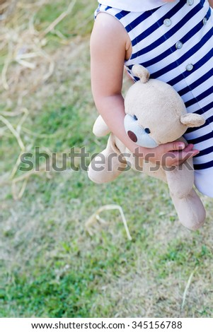 little girl holding her doll all time, parenting or love concept - stock photo