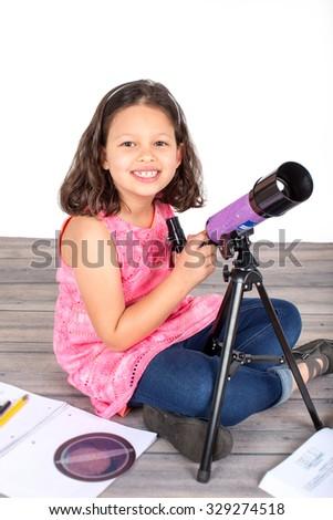 Little girl holding her telescope - stock photo