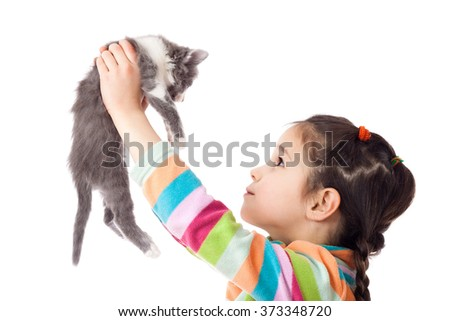 Little girl holding in hands adorable kitten, isolated on white - stock photo
