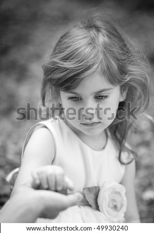 little girl holding mother's hand