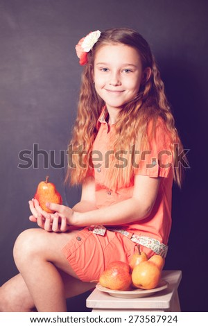 Little Girl holding Pear Fruit in her hands - stock photo