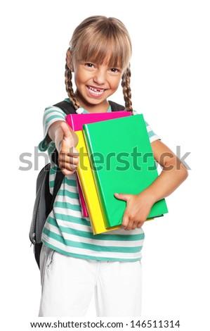 Little girl holding pile of books, isolated on white background - stock photo