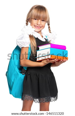 Little girl holding pile of books, isolated on white background