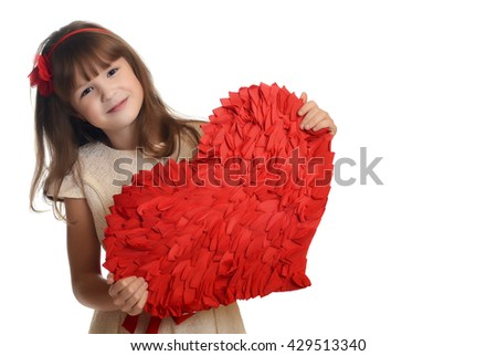 Little girl holding red heart, close-up isolated on white