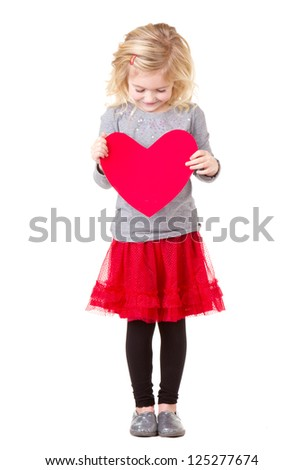 Little girl holding red heart, full length photo isolated on white - stock photo