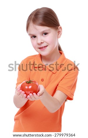little girl holding red tomato isolated over white