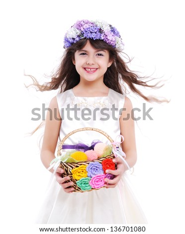 Little girl holding the basket with easter  eggs - stock photo