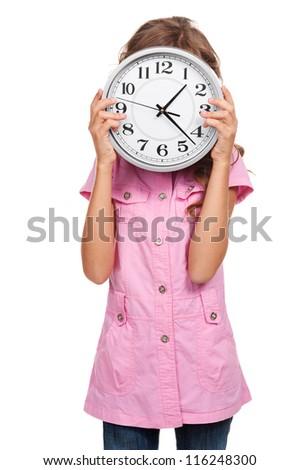 little girl holding the clock against white background - stock photo