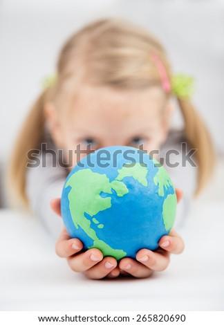 little girl holding the earth globe - stock photo