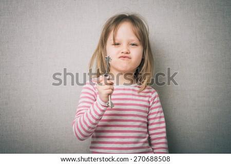 little girl holding the keys - stock photo